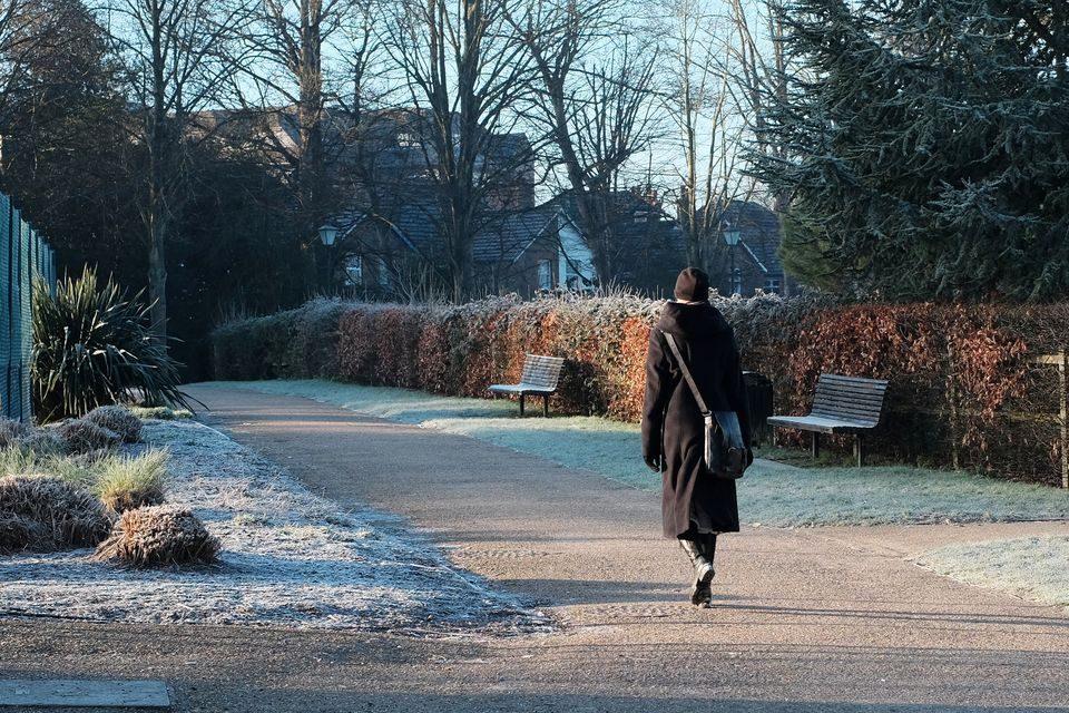 Woman walking to work on frozen morning
