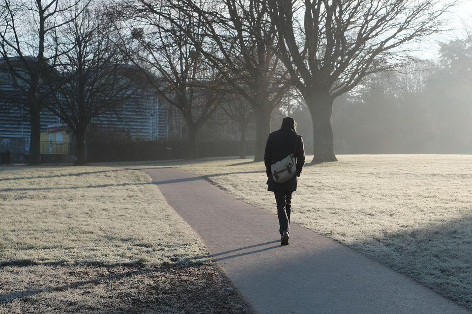 Man walking to work on frosty morning