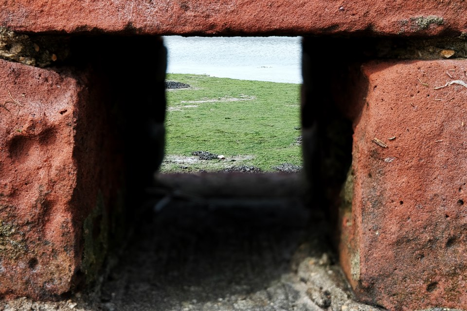 Through a hole in the wall