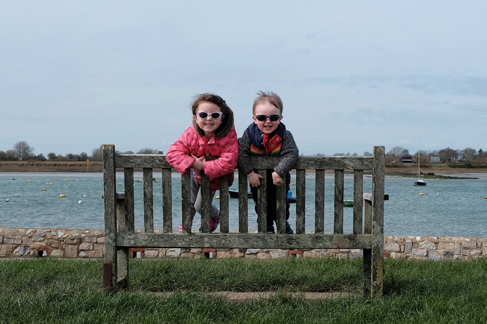 Kids standing on bench