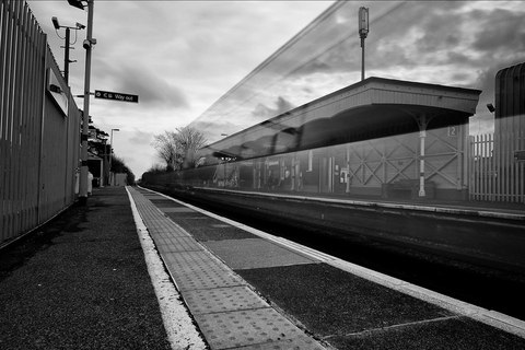 Long exposure train passing through station