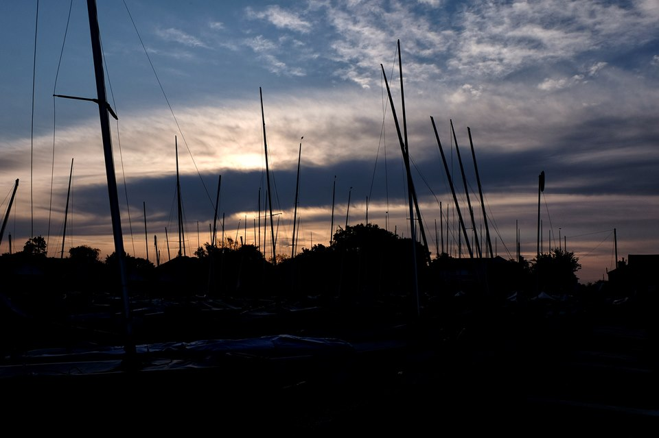 Boat masts at sunrise